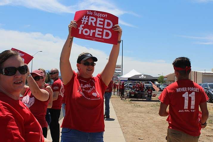 Emily Baker counselor at Lee Williams High School stands under the hot sun, with her #REDforED sign advocating for more education funding for the state of Arizona. (Photo by Vanessa Espinoza/Daily Miner)