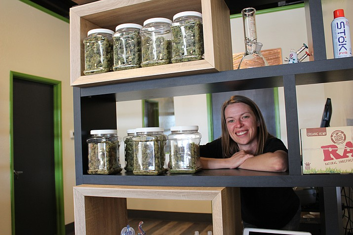 Stephanie Cronin, manager of Medusa Farms Dispensary, shows a variety of medical marijuana product available at the dispensary that opened May 1 at 3358 Andy Devine Ave. (Photo by Hubble Ray Smith/Daily Miner)