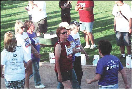 Survivors walk a special lap at a prior Relay for Life event. (Daily Miner file photo)