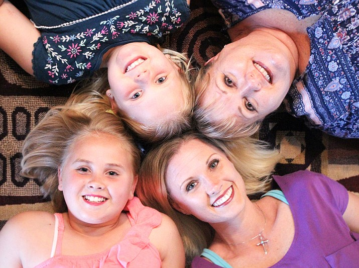 The Finch-Brown family, clockwise from top left: Briley Faith Brown, Sherrie Finch, Crystal Finch Brown, and Lainee Grace Brown. (Photo by Claire Whitley/Daily Miner)