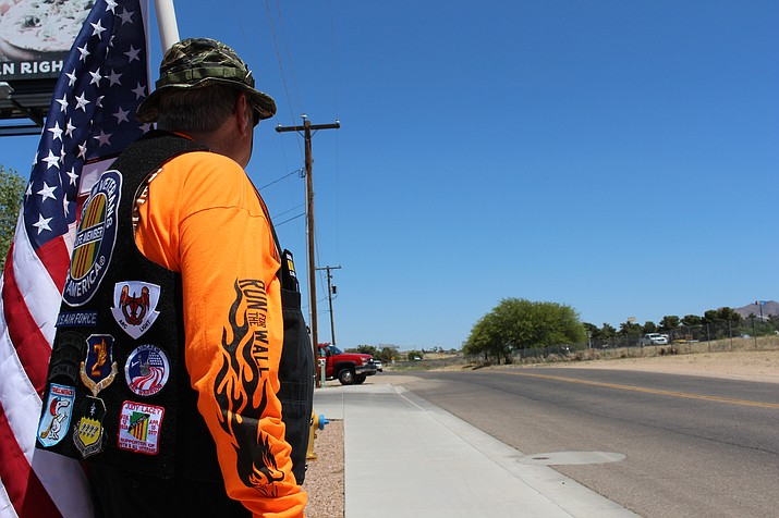Paul Pitts, Jerry Ambrose Veterans Council chaplain, holding the American flag welcoming the Run for the Wall participants outside of the Mother Road Harley Davidson. (Photo by Vanessa Espinoza/Daily Miner)