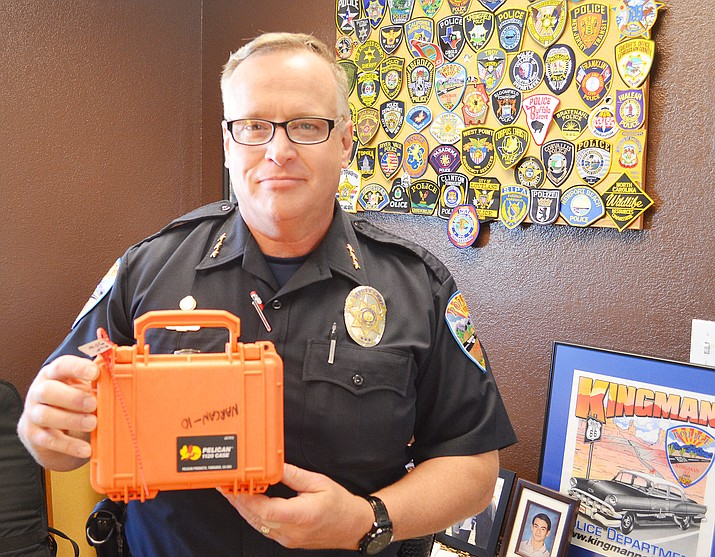 Kingman Police Department Deputy Chief Rusty Cooper shows off a NARCAN kit in this file photo from 2017 when KPD was the first department in Arizona to implement the life-saving program. A recent job posting for a Deputy Chief at KPD means another position is being added, not that Cooper is leaving the department. (Daily Miner file photo)