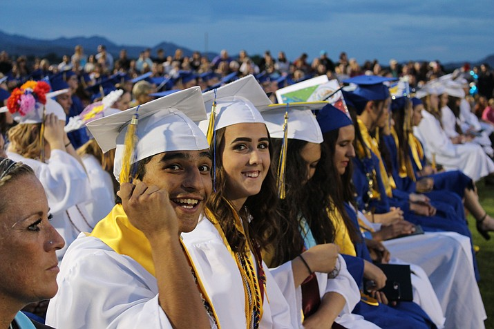 KHS students ready for the big movement to move their tassels to the left. (Photo by Vanessa Espinoza/Daily Miner)