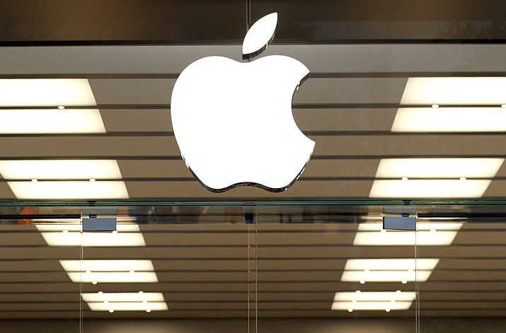 The Apple logo above a store location entrance in Dallas, Sept. 19, 2013. (Tony Gutierrez/AP Photo, file)