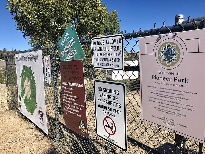 Nearly 30 signs have been installed at Prescott city parks, banning smoking of cigarettes, vaping, and e-cigarettes within 50 feet of the parks. (Cindy Barks/Courier)