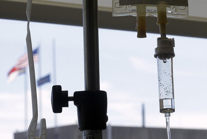 Chemotherapy is administered to a cancer patient via intravenous drip at a hospital in Durham, N.C. (Gerry Broome/AP, File)