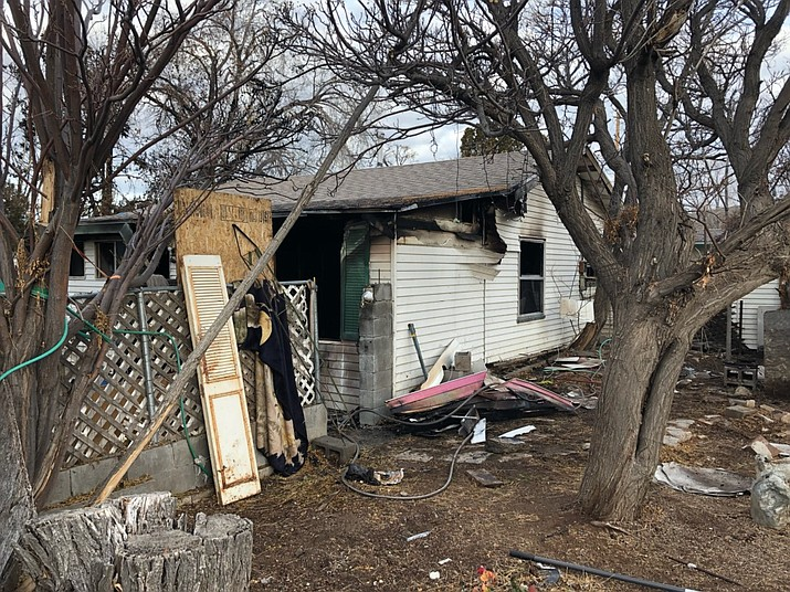 The aftermath of the house on Center Street that caught fire Tuesday, Jan. 8, 2018. The resident of the house was flown to a Las Vegas hospital, and the man lost three of his six dogs in the fire. (Photo by Shawn Byrne/Daily Miner)