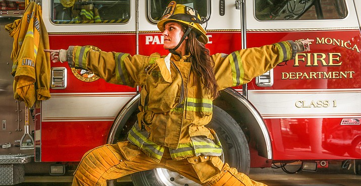 Firefighter Essie Titus poses for a photo by yoga photographer Robert Sturman for the Sedona Yoga Festival.