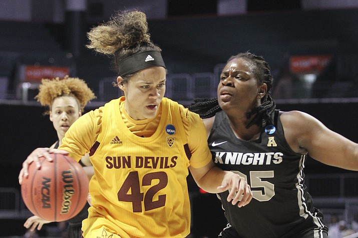 Arizona State forward Kianna Ibis drives against UCF forward Tolulope Omokore during their first-round game in the NCAA Tournament in Friday, March 22, 2019, in Coral Gables, Fla. (Luis M. Alvarez/AP)