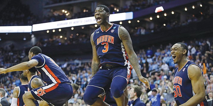 Auburn's Danjel Purifoy, center, and Austin Wiley, right,  celebrate near the end of the Tigers' win over North Carolina on Friday, March 29, 2019, in Kansas City, Mo. (Charlie Riedel/AP)