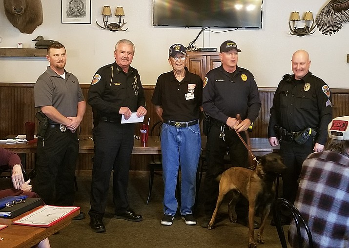 Kingman Social Club presented a check to Kingman Police Department K-9 unit. The club is looking for members and meets every third Tuesday of the month at the Dambar Steakhouse. (Daily Miner file photo)