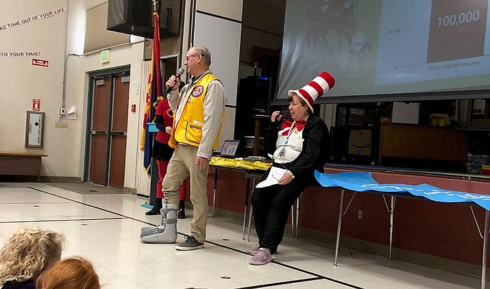 Prescott Sunrise Lions President Jim Myers presents $1,000 for the Lincoln Elementary School Reading and Feeding program, while Katie Harrell (Cat in the Hat) looks on. (Courtesy)
