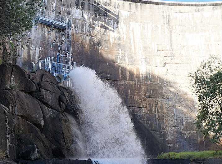 Water flows from the newly installed valve in the Watson Lake dam as a part of the City of Prescott's groundwater recharge and recovery program. Public Works Director Craig Dotseth says about 6.5 million gallons of water a day are currently being released from the lake. (Cindy Barks/Courier)