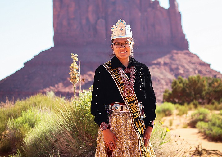 Miss Western Navajo 2018-2019 Amy N. Reeves-Begaye poses for a picture in front of one of the mittens at Monument Valley Tribal Park in Utah. (Photo/Cordell Granger)