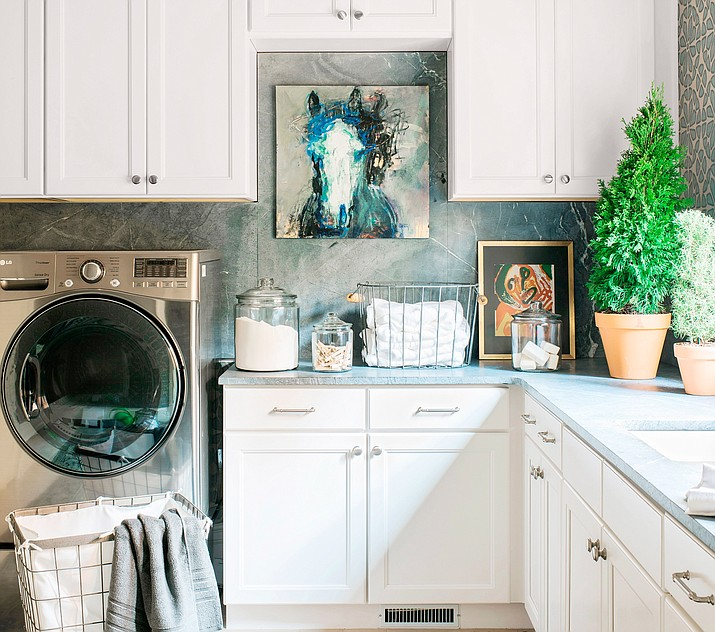 Interior designer Brian Patrick Flynn advises homeowners to have fun with color and patterns as they decorate a laundry room, adding art and other objects to make the space more personalized and appealing. (Robert Peterson/Rustic White Photography/Brian Patrick Flynn via AP)