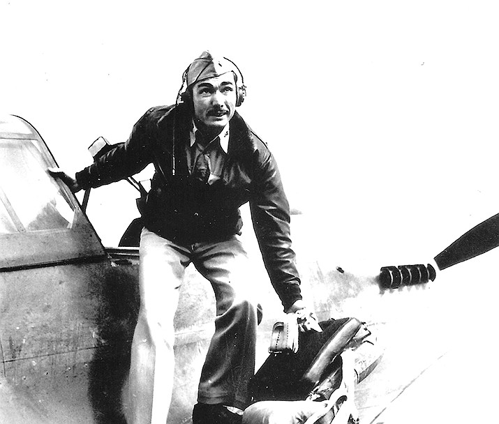 Major Frank Schiel, Jr. climbing out of an airplane. (Courtesy of the author and the family of Frank Schiel.)