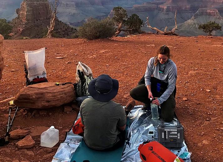 A Grand Canyon National Park EMS provider treats a patient near Cedar Ridge along the South Kaibab Trail. (Photo/NPS)