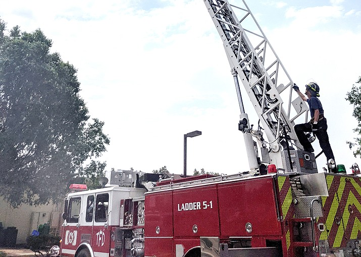 Tusayan Firefighter Jared Roberts exercises the aerial ladder during a training at Tusayan Fire District. The department is conducting a volunteer firefighter academy in October. (Photo/Tusayan Fire District)