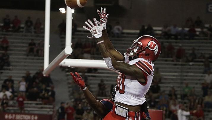 College: No. 23 Utah recovers late fumble to hold off Arizona