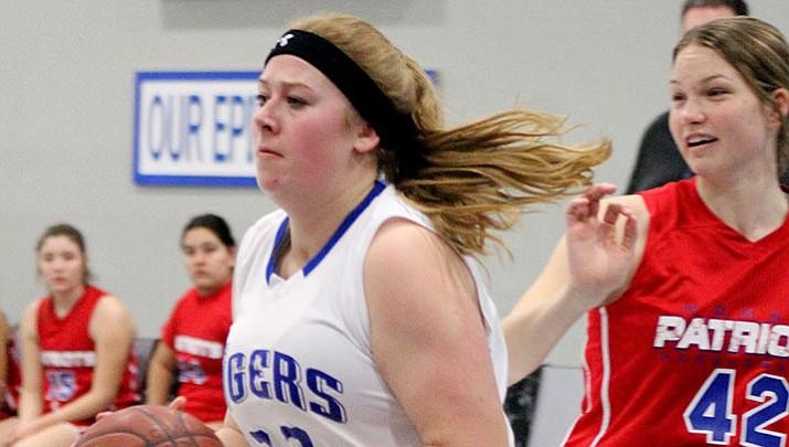 Prep Basketball: Lady Tigers take care of MALC, 55-35