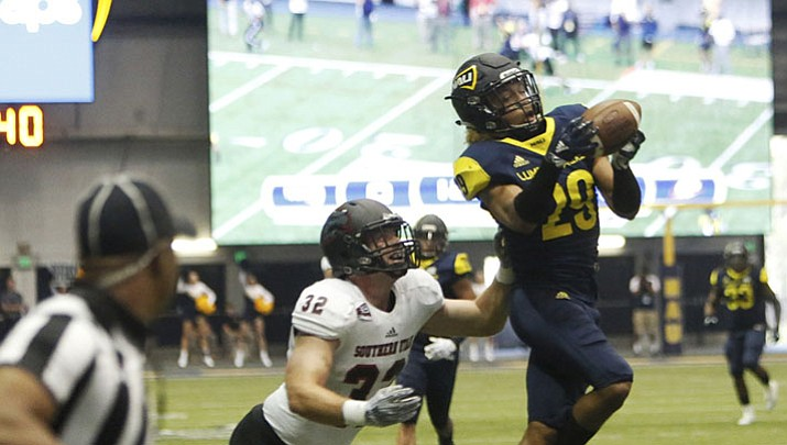 Bridge-Gadd's 4 TDs lead NAU past Utah State 31-23