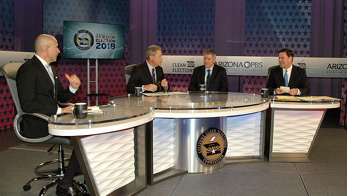 Ducey defends voucher decision during debate