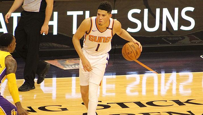 Booker's late onslaught lifts Suns past Mavs 121-100
