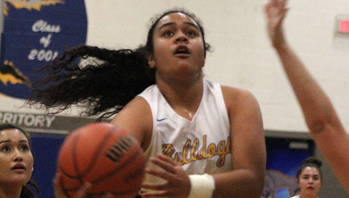 Prep Basketball: No. 8 ranked Lady Bulldogs rally for win over River Valley