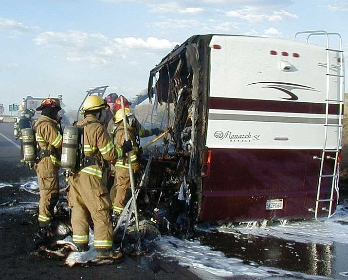 Courtesy Photo Firefighters from the Black Canyon and Mayer fire departments work May 5 to extinguish the hot spots in the rental RV that fire consumed on I-17 near Sunset Point Rest Area.