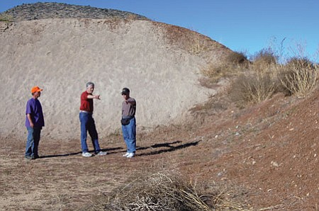 Prescott Sportsmen's Club Range Master Todd Farley, Prescott National Forest official Ken Simeral and club President Mark Fricke look over a new safety berm at the gun range earlier this month. The club also added sand to the larger adjacent backstop. <i>Photo courtesy Joanna Dodder</i>