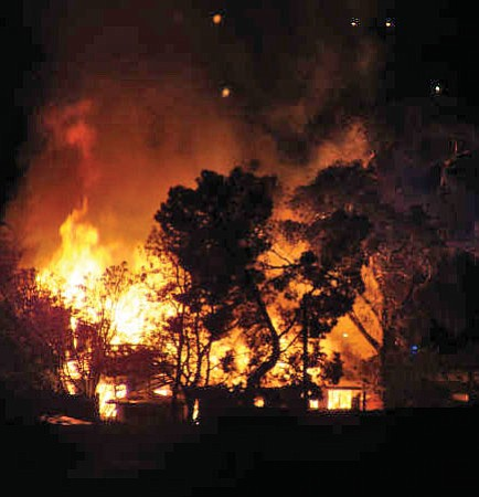 Fire fills the sky at 3 a.m. this past Thursday at a home on Albins Way.<br> Big Bug News/Diana Baker