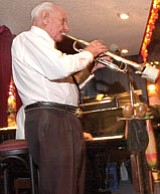 Ross, seen in February 2006 at the Pine Cone Inn in Prescott, where he enjoyed entertaining for many years.<br>  Courtesy Photo