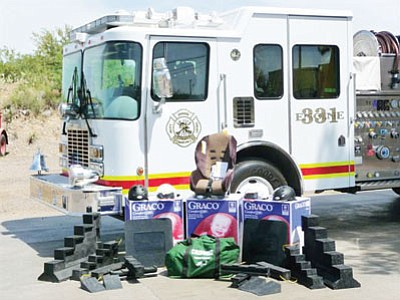 Photo shows items Black Canyon Fire was able to purchase through a grant from the Governor's Office of Highway Safety, including bike helmets and baby car seats.<br> Courtesy Photo/Black Canyon Fire
