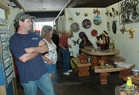 Shoppers to the indoor Red House Marketplace in Prescott Valley peruse a booth of patio items from Creative Iron Patio out of Surprise, Ariz.<br> Photo Courtesy Cheryl Hartz