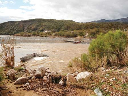 More than 30 people still were stranded on the west side of Maren Ave. in Black Canyon City Saturday after floods obliterated their river crossing.<br> Courtesy Photo/Tom Birch