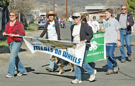 Marchers participate in this past year's March for Meals in Mayer. This year, all the money raised will stay with the local program and help Mayer Meals on Wheels serve more than 12,000 hot meals annually to homebound from Dewey-Humboldt to Cordes Lakes.<br> FilePhoto/Heidi Dahms Foster