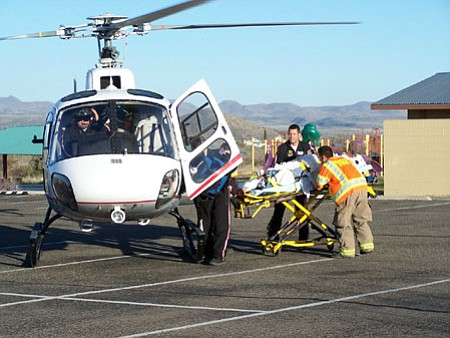 Emergency personnel load one of two victims of a two motorcycle accident on I-17 three miles south of Cordes Junction on Friday evening into a helicopter for a flight to John C. Lincoln North Mountain Hospital.<br>  Photo courtesy Mayer Fire Dept.