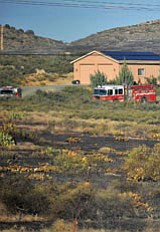 A Central Yavapai fire truck sits parked next to a home that was in the path of a brush fire inear the intersection of Perry Lane and Highway 69 Friday afternoon.<br> Photo courtesy of Matt Hinshaw
