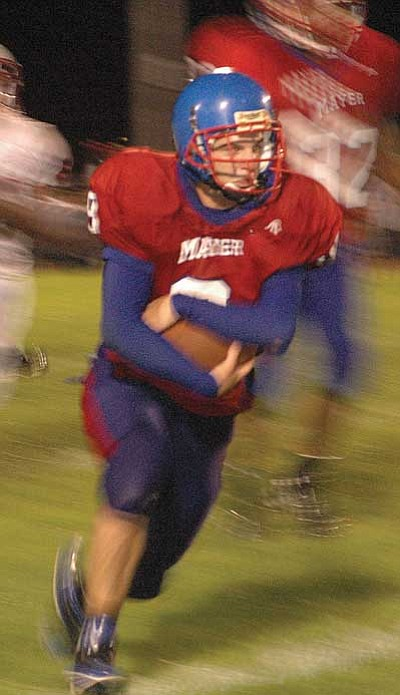 Mayer junior David Atkerson appeared as a blur to The Orme School defense for most of Friday night. Atkerson ran for 296 yards on 48 carries and scored four touchdowns.<br> BBNPhoto/Cheryl Hartz