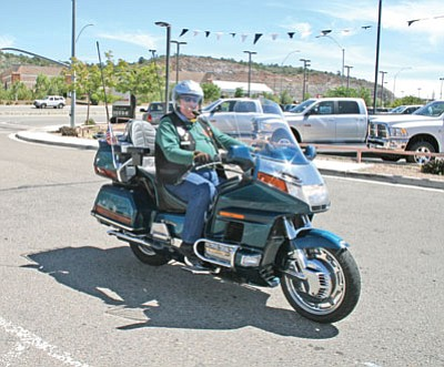 Bill Noe rides into York Motors in Prescott Saturday during the 9-11 Freedom Ride, and is one of the organizers of the upcoming benefit ride – Yavapai Motorsports Fun Run for United Way on Sept. 25 in Prescott.<br> Salina Sialega/ Special to the BBN
