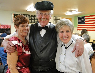 BBNPhoto/Pat Williamson<br> Ann and Larry Canaday and Trish Rasmussen are all smiles at the Mayer Elders Club Casino night. The event filled the club and all the proceeds will go to benefit Meals on Wheels.