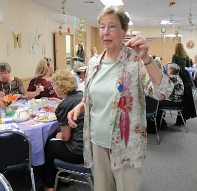 BBNPhoto/Pat Williamson<Br>Anise Grand shows off one of the butterfly hangings that made attractive luncheon decorations.