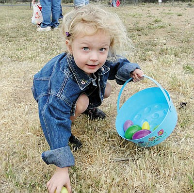 Jaiden Ridge, then-3 years old, picks up an egg during the 2011 Cordes Lakes Community Center Easter Egg Hunt. The 2019 egg hunt will be on Saturday, April 20. (Pat Williamson/Courtesy, file)