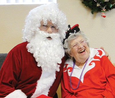 Photo courtesy Pat Williamson<br /><br /><!-- 1upcrlf2 -->Betty Digges, with her ever-present smile, hams it up with Santa at the Cordes Lakes Community Center this past Christmas.