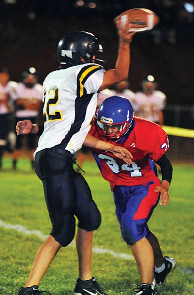 File photos courtesy Les Stukenberg<br> Atkerson rushed for 2,081 yards on 242 carries and had 32 touchdowns in 10 games including the playoffs in 2010. Right, Justin Allen, No. 34, makes  a tackle.