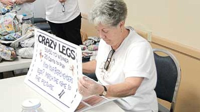 Cordes Lakes Daze was a success.  Jean Chester ponders the Crazy Legs guessing game of board members' legs. The winner, with seven of 10 correct, was Annie Wales.<br /><br /><!-- 1upcrlf2 --><br /><br /><!-- 1upcrlf2 -->Pat Williamson/Courtesy photo