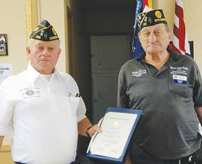 Right, Dist. 8 Regional Cmdr. Wilbur Quick, was on hand to present three awards to the Cordes Lakes American Legion Post 122 during its November meeting. Post 122 member Doug Irvine accepted the awards on behalf of Cmdr. Ron Johnson, who could not attend. <br /><br /><!-- 1upcrlf2 --><br /><br /><!-- 1upcrlf2 -->BBNPhoto/Pat Williamson