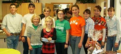 Courtesy Photo<br /><br /><!-- 1upcrlf2 -->Members of the Lonesome Valley Wranglers 4-H Club joined again to serve dinner to more than 100 people who came to enjoy the great food cooked up by the chefs at Mayer Elders Center.