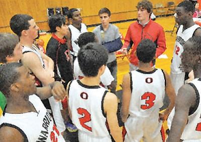 Matt Hinshaw/The Daily Courier<br /><br /><!-- 1upcrlf2 -->The Orme School boys' basketball team huddles up around first-year coach Grant Hendrikse during a game against Chino Valley Tuesday in Orme.