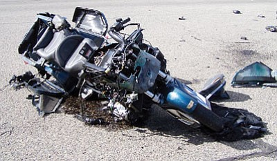 Courtesy Photo/Mayer Fire<br /><br /><!-- 1upcrlf2 -->A man and his 12-year-old passenger suffered serious injuries on Jan. 31 when the rear tire on this motorcycle blew out at HIghway 69 and Findley Rd.